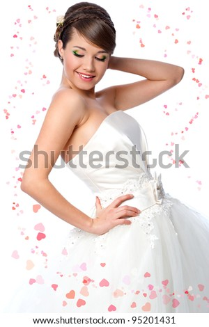 Slim beautiful woman  wearing luxurious wedding dress. Bride on white background with hearts - stock photo