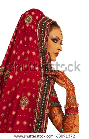 Slim beautiful woman wearing luxurious wedding dress over white studio background - stock photo