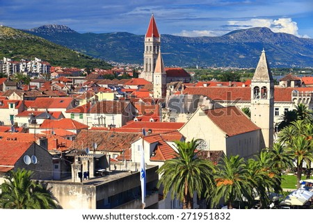 Slim church towers above traditional buildings of the old town of Trogir, Croatia - stock photo