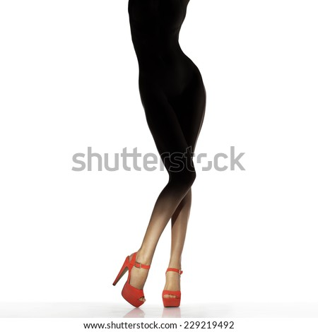 Slim female legs in red shoes isolated on white. Conceptual fashion art photo - stock photo
