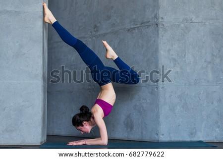 young beautiful woman practicing yoga mountain stock photo