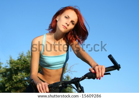 slim girl on bicycle outdoors