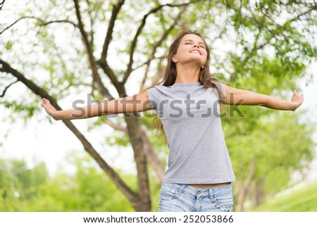 Slim girl stretching out outdoors - stock photo