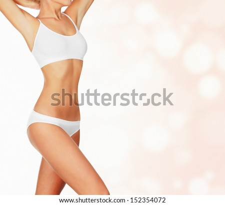 Slim woman against abstract background with circles and copyspace  - stock photo