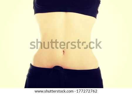 Slim woman belly, isolated on white background - stock photo