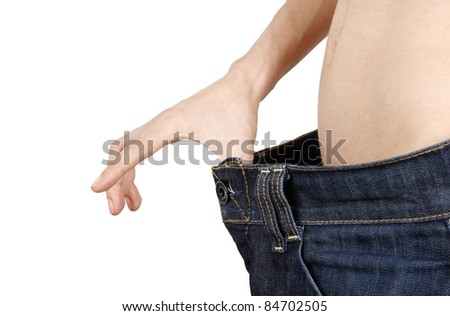 Slim woman in big jeans isolated on white background - stock photo