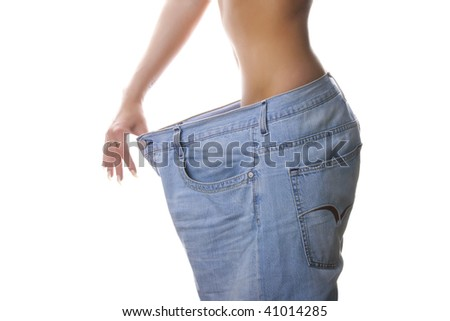 Slim woman in large jeans. Isolated. - stock photo