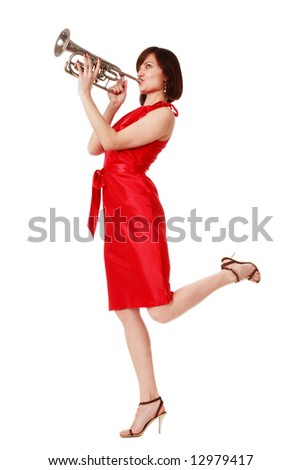 Slim woman in stylish red dress hopping on white background and playing the trumpet - stock photo