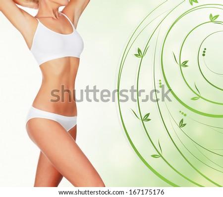 Slim woman in white underwear, green floral background - stock photo