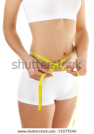 Slim woman measuring her body isolated on white background