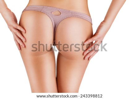 Slim woman's body. Close up of buttocks in panties isolated on white background - stock photo