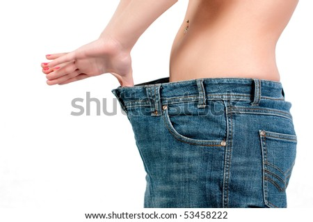slim woman trying on her big jeans