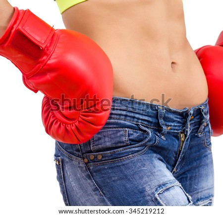Slim Woman with boxing gloves, fitness women showing her thin waist, The fight for healthy body, Caucasian young female in jeans, Unrecognizable person.Diet and weight loss concept. - stock photo