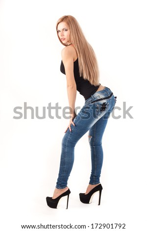 Slim young lady in jeans - stock photo