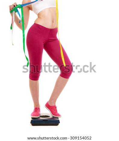 Slimming and weight loss. Woman girl holding tape measures on weighing scale. Healthy lifestyle concept. Isolated on white. - stock photo