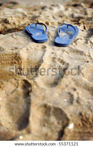 Slippers on the beach - stock photo