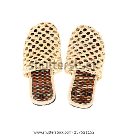 Slippers woven from rattan on white background