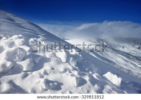 Slope in the mountains covered with fluffy snow
