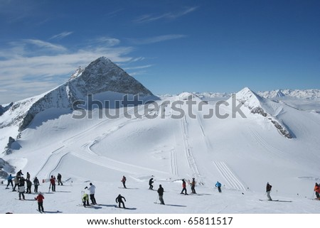 Slope view. Skiers preparing to ski in the Alps.
