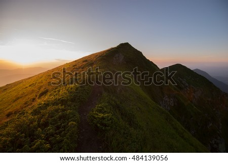 slopes of the mountains and the sunset beautiful summer evening in the Ukrainian Carpathians