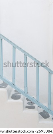 Sloping concrete stair steps and wood handrail - stock photo