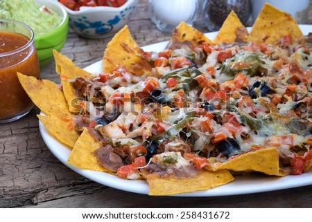 sloppy nacho  - stock photo