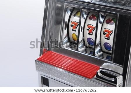 Slot machine and jackpot three seven on light background - stock photo