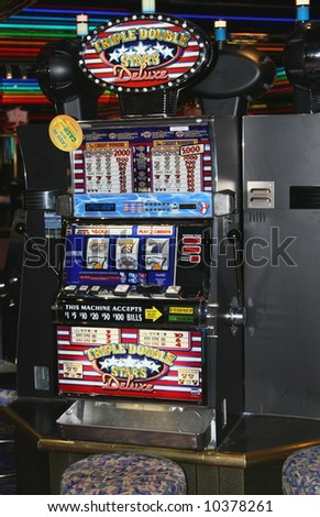 Slot machine in a casino on a cruise ship - stock photo
