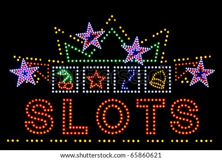 slots gambling neon sign isolated on black background - stock photo