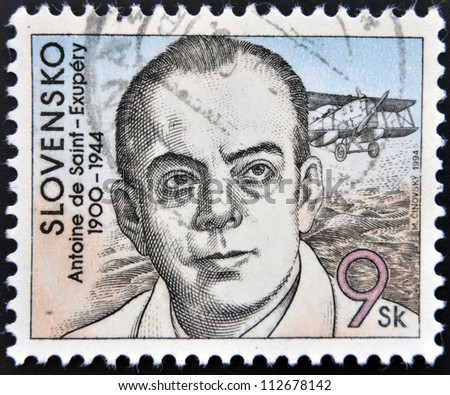 SLOVAKIA - CIRCA 1994: A stamp printed in Slovakia shows hows the author of The Little Prince, Antoine de Saint-Exupery, circa 1994 - stock photo