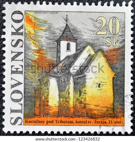 SLOVAKIA - CIRCA 1994: A stamp printed in Slovakia shows St. George Church, circa 2005 - stock photo