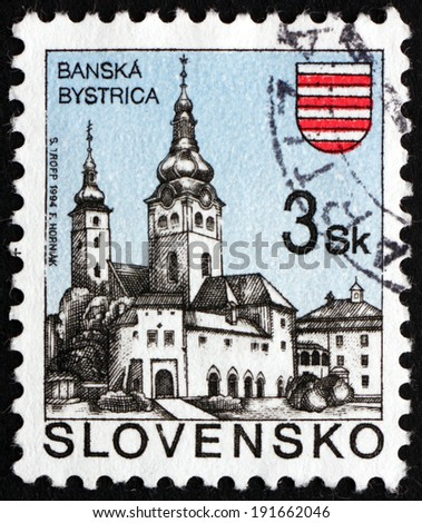 SLOVAKIA - CIRCA 1995: a stamp printed in the Slovakia shows Church, Banska Bystrica, circa 1995 - stock photo