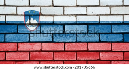 Slovenia flag painted on old brick wall texture background - stock photo