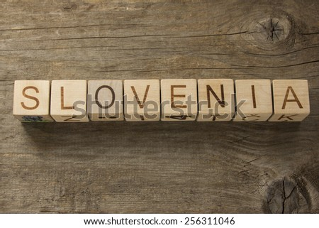 Slovenia on a wooden background - stock photo