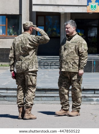 SLOVIANSK, UKRAINE - JULY 5, 2016: President of Ukraine Petro Poroshenko has awards soldier in Sloviansk  at ceremonial meeting in honor of the second anniversary of liberation from Russian fighters