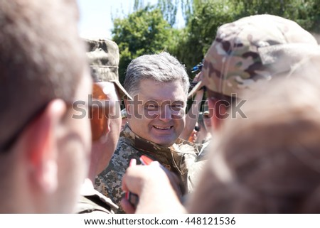 SLOVIANSK, UKRAINE - JULY 5, 2016:  President of Ukraine Poroshenko berween the soldiers of Armed Forces of Ukraine in Sloviansk  at ceremonial meeting