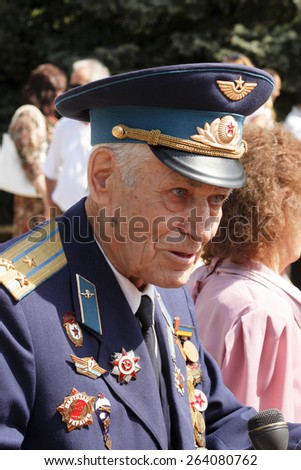 SLOVIANSK, UKRAINE - MAY 9, 2012: MAY 9: Unidentified Soviet Army veteran of World War II on Victory day in Sloviansk on May 9, 2012. Veteran reminisces about the past, in an interview