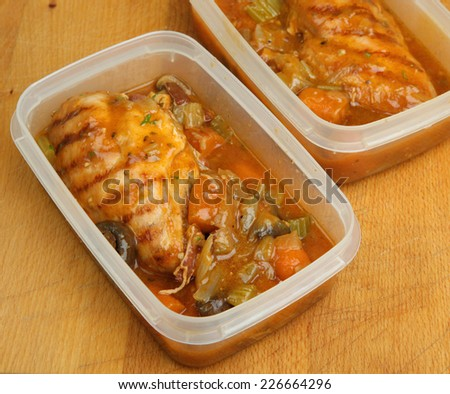 Slow-cooked chicken casserole portions being prepared for chilling or freezing. - stock photo