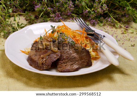 Slow cooker beef brisket with coleslaw and thyme - stock photo