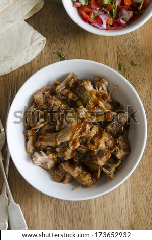Slow-cooker chipotle pulled pork with salsa - stock photo