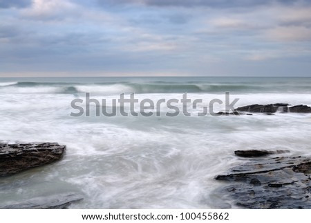 Slow shutter seascape. View from Trebarwith Strand Beach. - stock photo