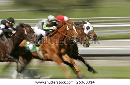 Slow shutter speed rendering of racing jockeys and horses