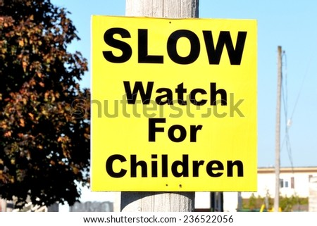 Slow watch for children sign - stock photo