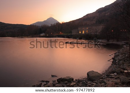 Sloy power station and mountain view at Sunset, Inveruglas, on the west bank shore of Loch Lomond - stock photo