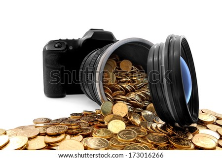 Slr camera and golden coins - stock photo