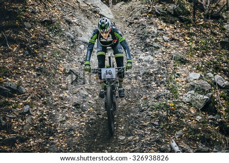 Sludorudnik, Russia - September 13, 2015: top view racer biker riding through woods during Blagikh Racing Cup mountain bike - stock photo