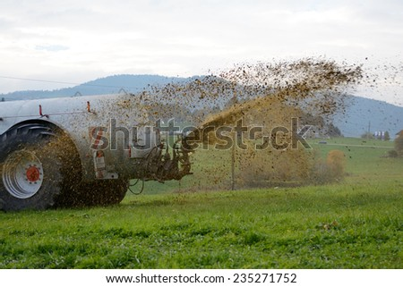 Slurry application on a meadow - stock photo