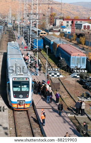 SLYUDYANKA, RUSSIA - OCTOBER 2: Passengers arrive at the Slyudyanka railway station on lake Baikal in the middle of Trans-Siberian railway on Oct 2, 2010 in Slyudyanka, Russia. Trans-Siberian is the longest railway in the world (9288 km).