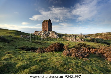 Smailholm tower a 15th century tower house and surrounding landscape - stock photo