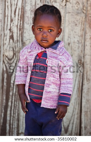 small African girl portrait , outdoors, wooden door background - stock photo